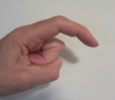 finger in mocking stork gesture