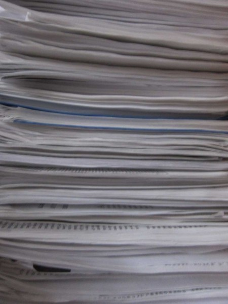 stack of scholarly papers on sex differences